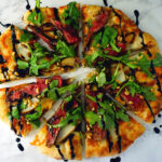 Flank Steak Pizza with pear, boursin cheese, arugala and balsamic glaze