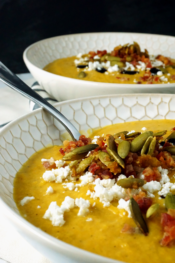 creamy butternut squash pumpkin soup with apples, pancetta and goat cheese