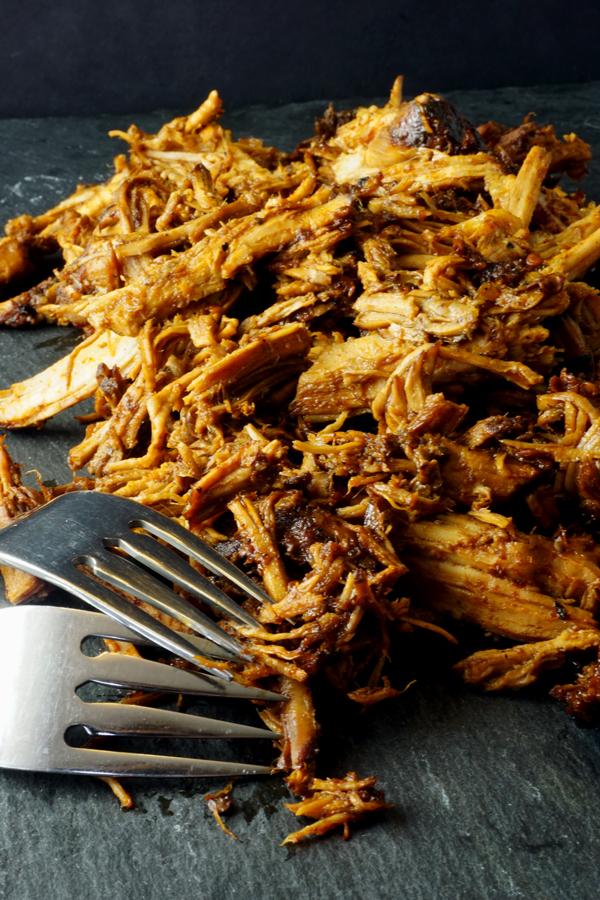 tender, shredded braised honey chipotle pork roast with two forks