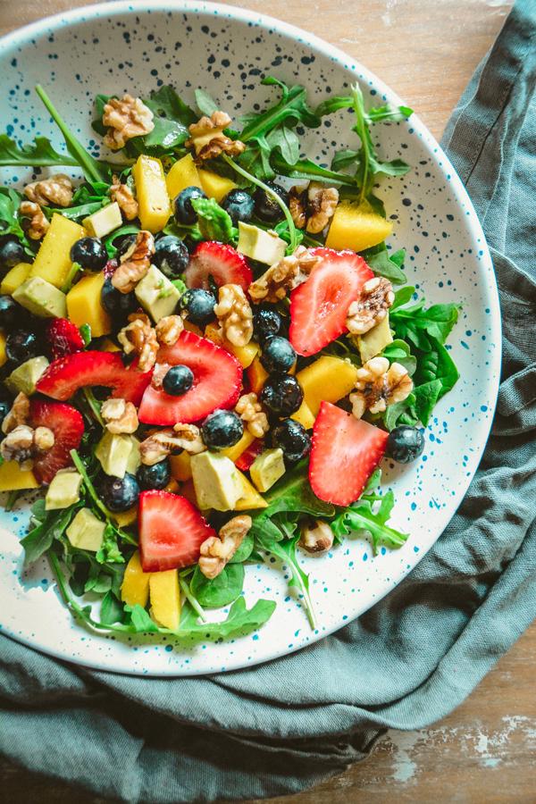 arugula and strawberry salad with cayenne lemon vinaigrette by Calm Eats