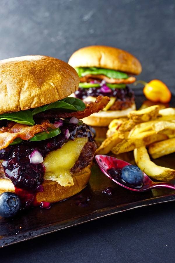 Habanero-lime blueberry compote tops two juicy bacon cheeseburgers with a side of fries