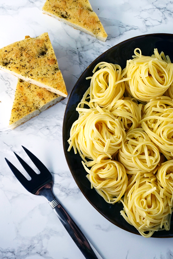 Linguine pasta swirled into nests on a plate