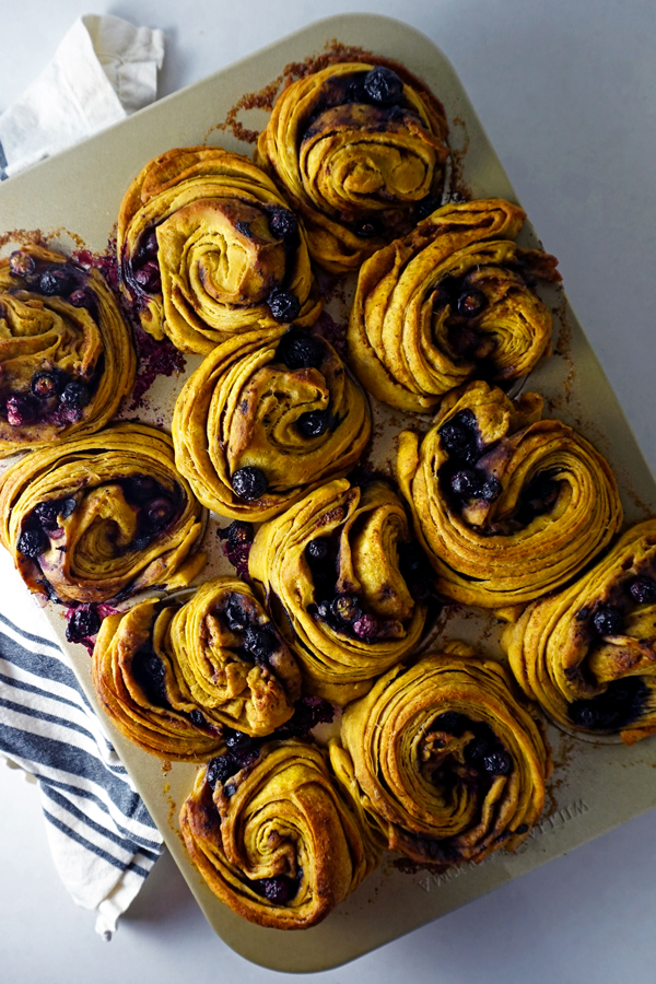 Freshly baked pumpkin blueberry morning buns overhead at an angle