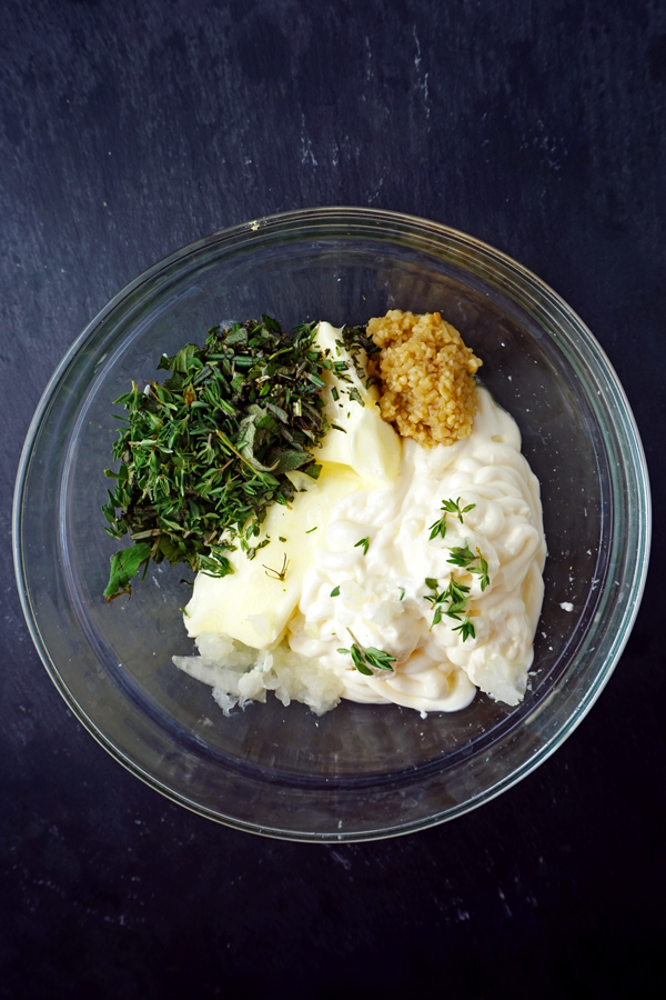 mayonnaise butter herbs and lemon zest in a bowl