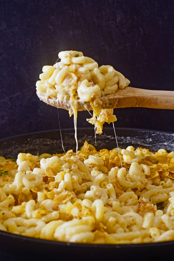 melted, gooey cheese stretching as a wooden spoon serves fancy macaroni and cheese