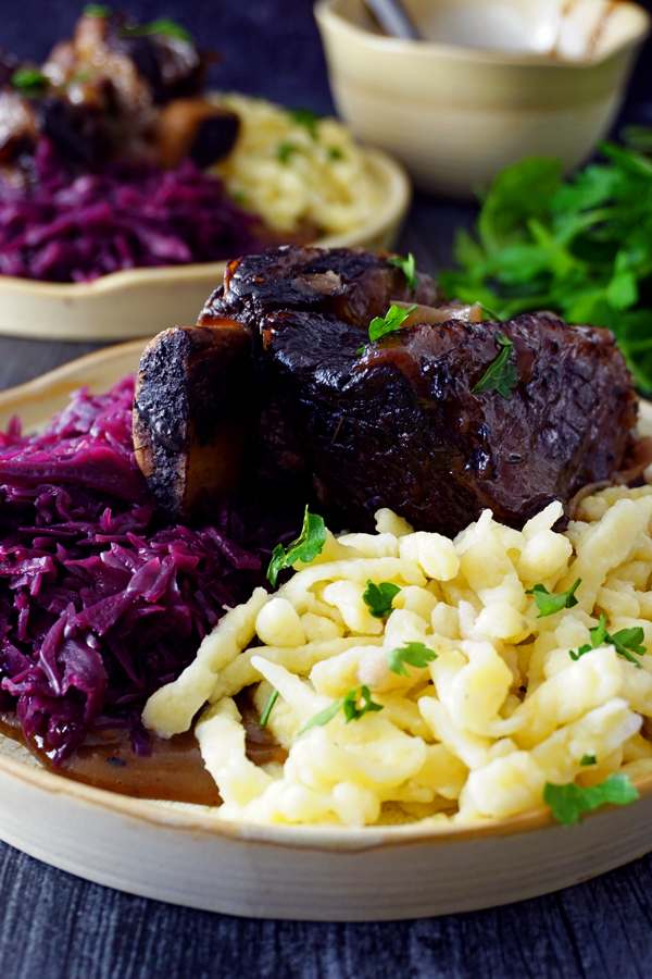 close-up image of german sauerbraten made with short ribs