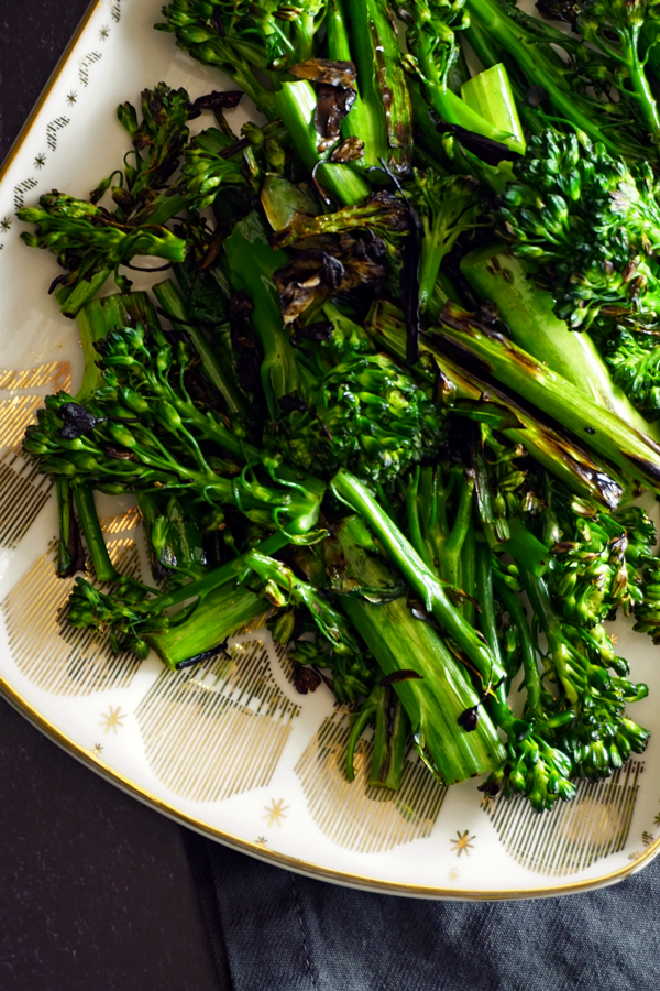 stovetop charred broccolini on a metallic plate